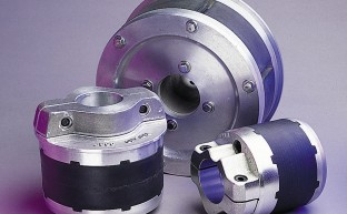 Rugged, high torque chucks for rewinding or unwinding rolls with or without shafts